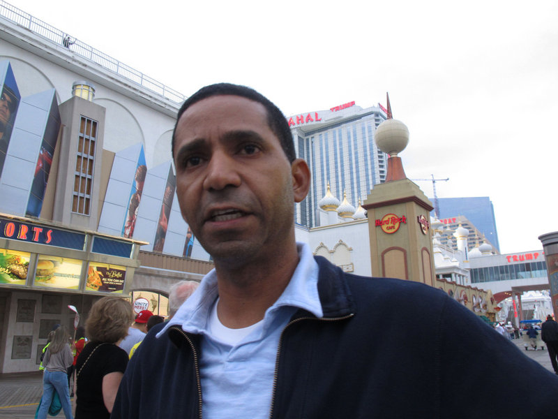 Marcos Vidal, a housekeeper at Resorts Casino Hotel in Atlantic City, N.J., has seen his pay cut from $14.55 an hour to $9.83. Vidal says he's been forced to eliminate cable TV, Internet service, long-distance calls and sending money to his mother in the Dominican Republic.