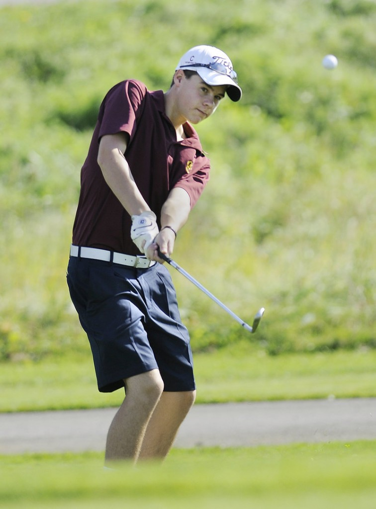 Jackson Berman of Cape Elizabeth keeps his eyes on the ball while sending it onto the green during the Class B state meet, which was won by York.