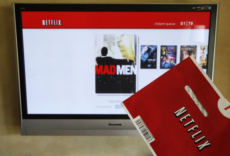 Netflix's CEO says the company is abandoning its widely panned decision to separate its DVD-by-mail and Internet streaming accounts.