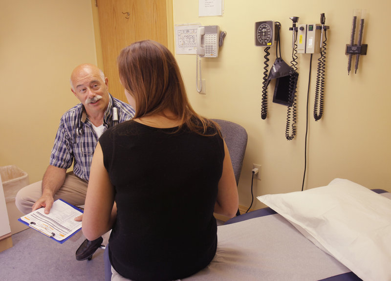 At his office in Jonesport, Dr. Steven Weisberger talks with a patient going through treatment for opiate addiction. There a shortage of addiction doctors in his part of the state.