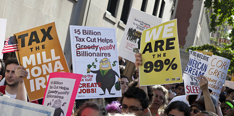 Anti-Wall Street protesters gather outside 1185 Park Ave., where JPMorgan Chase CEO Jamie Dimon reportedly has an apartment, during a march in New York on Tuesday.