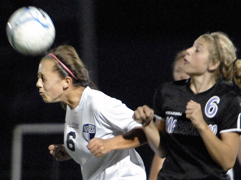 Alexis Sivovios of Deering heads the ball away from Korinne Bohunsky of Marshwood during the second half of Deering's 3-0 victory Tuesday.