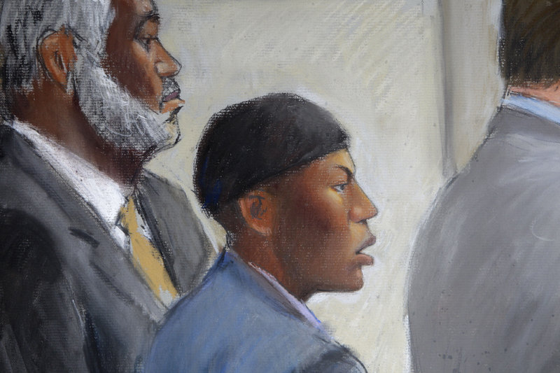 An artist's sketch shows Umar Farouk Abdulmutallab, center, in court with Anthony Chambers, his lawyer.