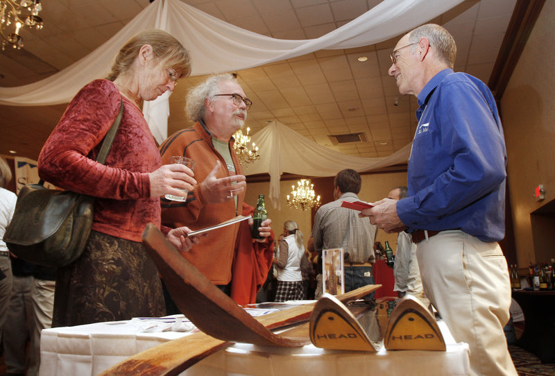 Greg Sweetser, right, executive director of Ski Maine Association, talks with Jay York, a ski instructor at Mt Abram, and Kris Horton, a ski enthusiast from Portland, at the Ski Season Launch Party at Eastland Park Hotel.