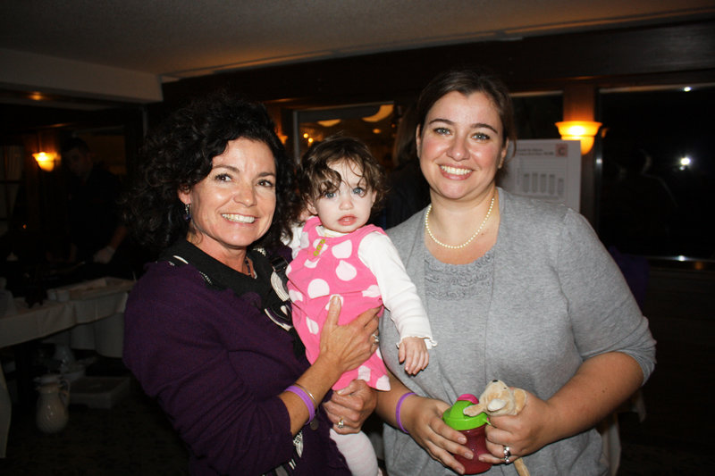 Board member Geri Tamborelli, nursing director at Maine Medical Center's Family Birth Center and NICU, who is holding NICU graduate Anne-Marie Fay, and March of Dimes Ambassador mom Liz Fay of Naples.