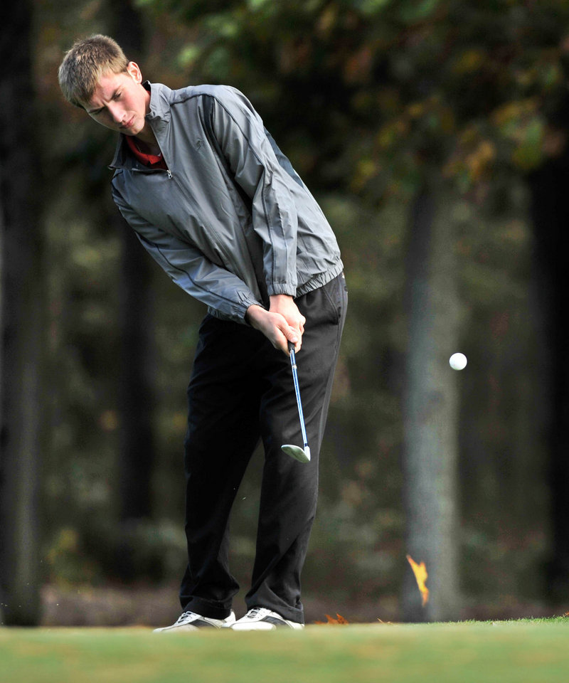 Ben Bell of Sanford chips onto the first green during the state golf championships at Natanis Golf Course. Bell shot a 75 to tie Joe Walp of Deering for first place in Class A.