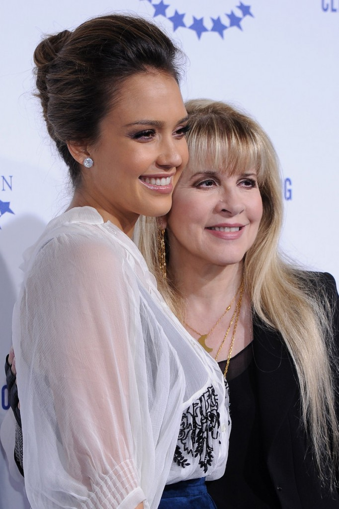 Actress Jessica Alba, left, and singer Stevie Nicks arrive at the Clinton foundation gala in Hollywood, Calif.