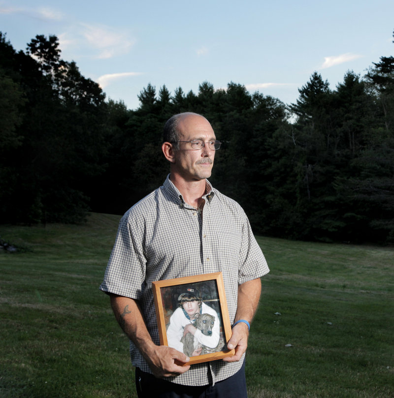 Matt Rix holds a photo of his son, Matty, in his backyard in South Berwick. Matty, who planned to join the Marines, died of a fentanyl overdose in 2009.