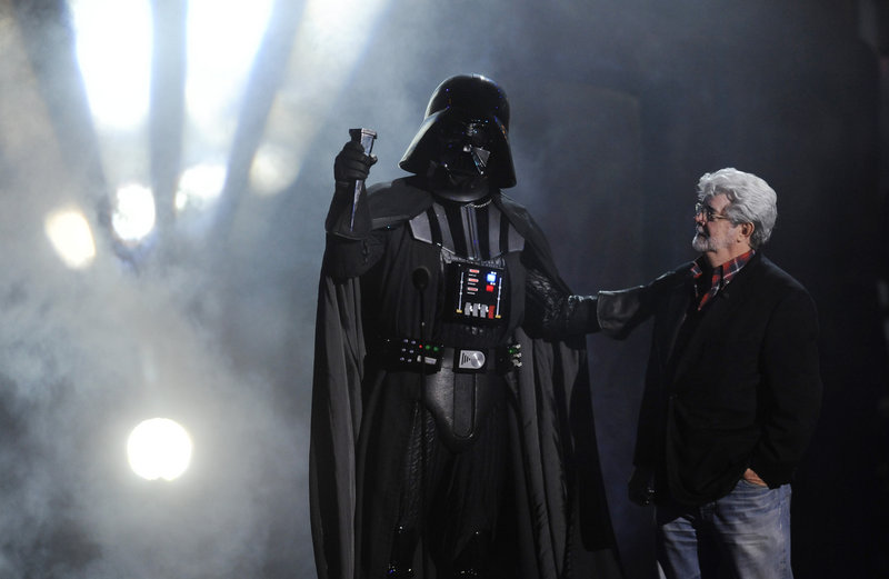 """""""Darth Vader"""" accepts the Ultimate Villain award from George Lucas at the 2011 Scream Awards on Saturday."""