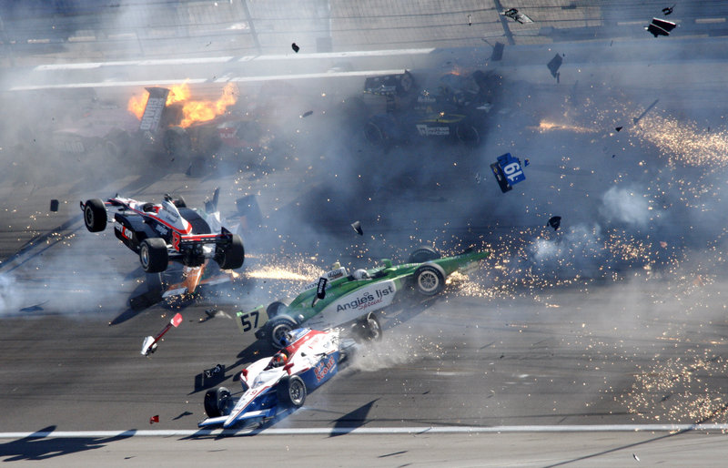Will Power's car goes airborne as cars crash during the Indy 300 on Sunday. Driver Dan Wheldon, a two-time Indy 500 winner, died in the dramatic accident.