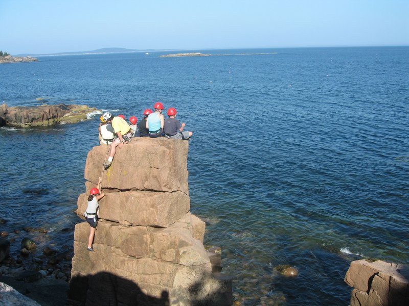 A group of summer campers summits Pebble Beach Pinnacle.