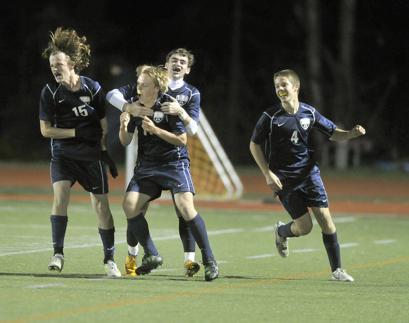 John Ewing/Staff Photographer Michael Hickey, left, Theo Bullock, Pierce Twohig and Josh Mitchell of York celebrate Bullock's goal early in the second half Monday night. The Wildcats (11-1-2) locked up the top seed in the Western Class B tournament. Yarmouth finished 9-4-1 and will be the No 2 or 3 seed.