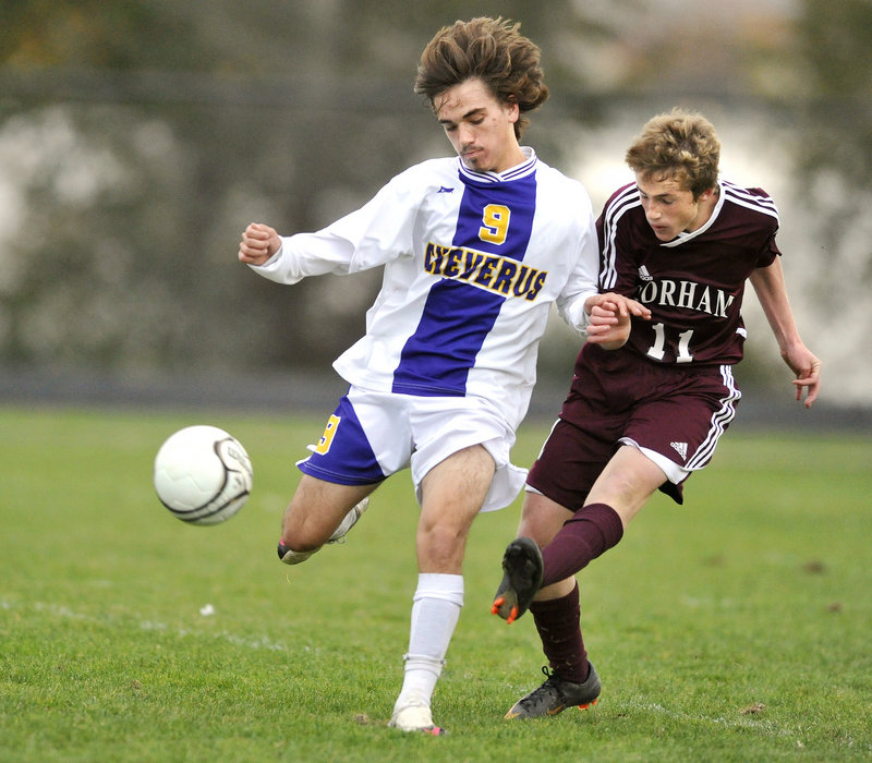 Gorham's #11, Mike Lubelczyk, gets off a shot while defended by Cheverus' #9, Alex Hoglund.