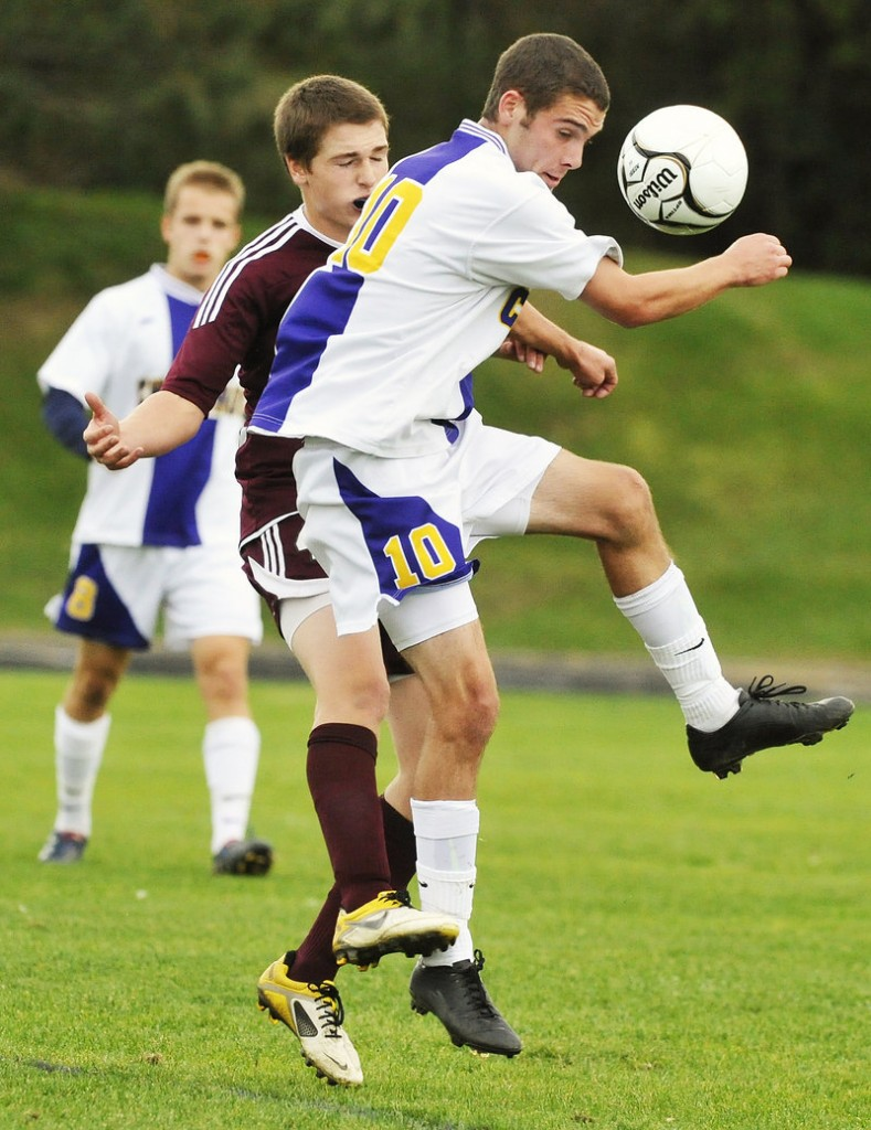 Gorham's Kevin Lubelczyk, rear, challenges Cheverus' Nick Melville as Melville heads the ball away Tuesdays. The Rams won, 6-3.
