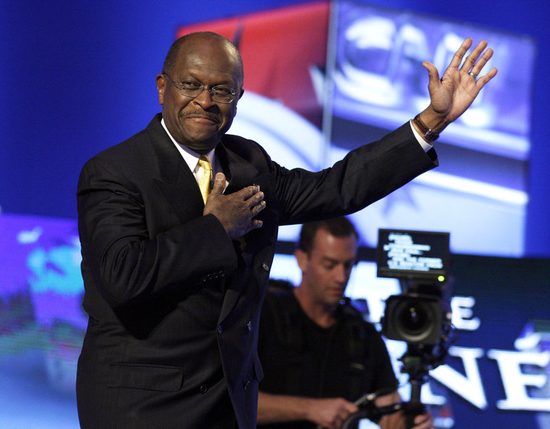 s to the crowd before the debate Tuesday. Cain once again found himself on the defensive as his 9-9-9 tax plan came under attack.