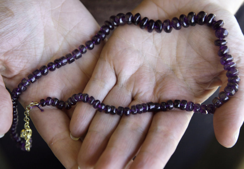 To pull in customers for the holidays, Stauer is giving away amethyst necklaces. A third of customers who took advantage of a similar promotion in 2009 bought additional items.