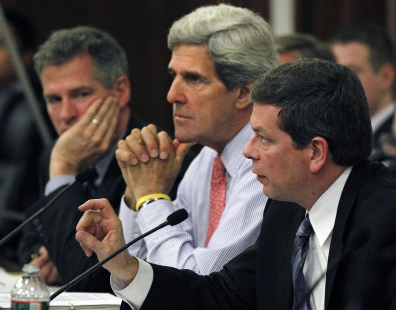 U.S. Sens. Scott Brown, R-Mass., left, John Kerry, D-Mass., center, and Mark Begich, D-Alaska, listen at a hearing Monday in Boston on the state of the Massachusetts fishing industry. Kerry has requested 11 changes in a new fishing management system.