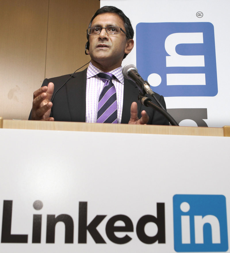 Arvind Rajan, head of Asia operations for LinkedIn, speaks during a news conference Thursday in Tokyo to launch the job service in Japanese. It is LinkedIn's first Asian language platform.