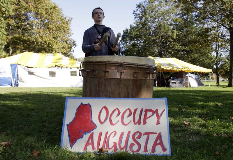 Curtis Cole of Pittston pounds drums in a park across from the State House in Augusta on Monday. A letter writer says such movements will shape the next election.