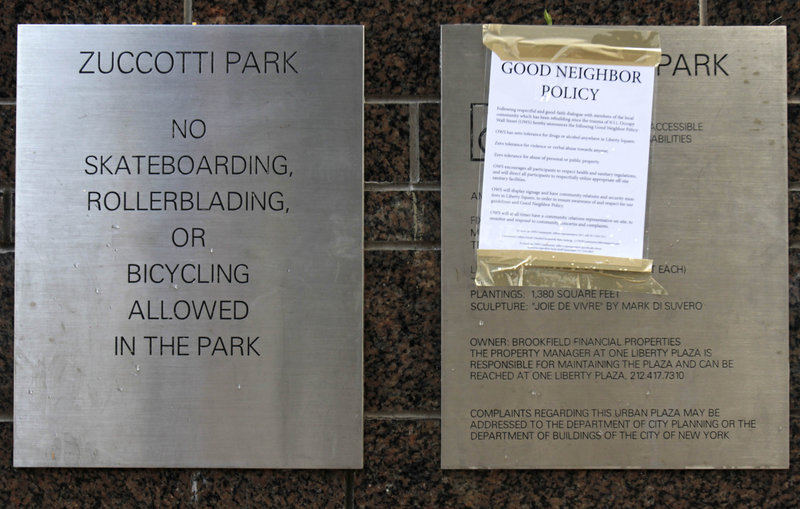 "A ""Good Neighbor Policy"" is posted next to the Zuccotti Park rules in New York Thursday."