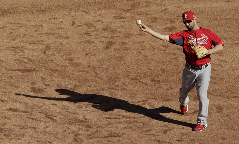 Daniel Descalso, a third baseman for the St. Louis Cardinals, throws batting practice Friday in preparation for tonight's Game 3 of the World Series against the Texas Rangers. Each team has one victory.