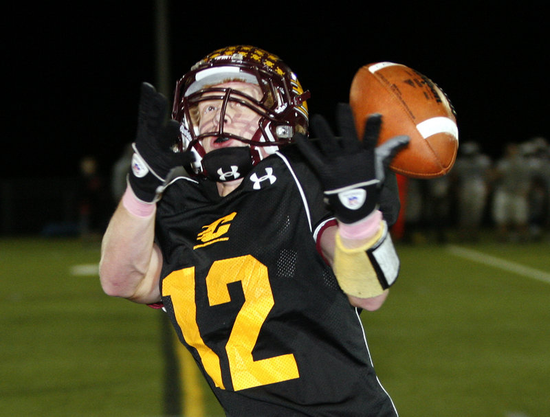 Derek Roberts of Cape Elizabeth bobbles the ball before making a catch Friday night. Cape fell at home to Mountain Valley, 20-14.