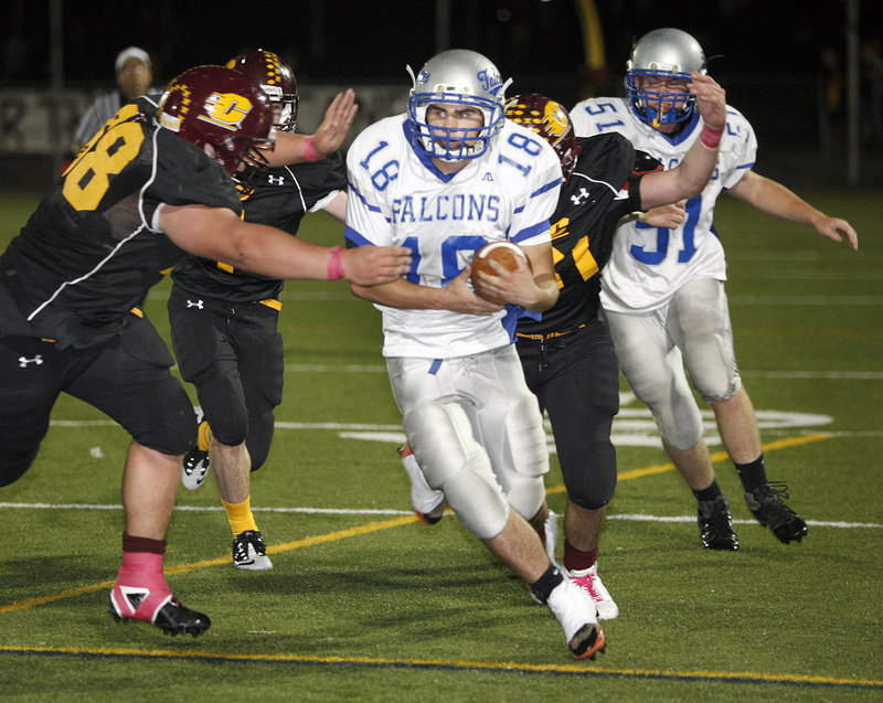 Andrew Lavallee of Cape Elizabeth reaches out to bring down Kyle Duguay of Mountain Valley during Mountain Valley's 20-14 victory Friday night.