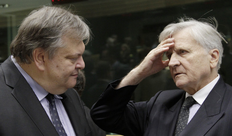 Greek Finance Minister Evangelos Venizelos, left, talks to European Central Bank President Jean-Claude Trichet in Brussels on Saturday. New rules would require the EU's biggest banks to raise about $140 billion to ensure that they could withstand a panic caused by a cut to Greece's debt.