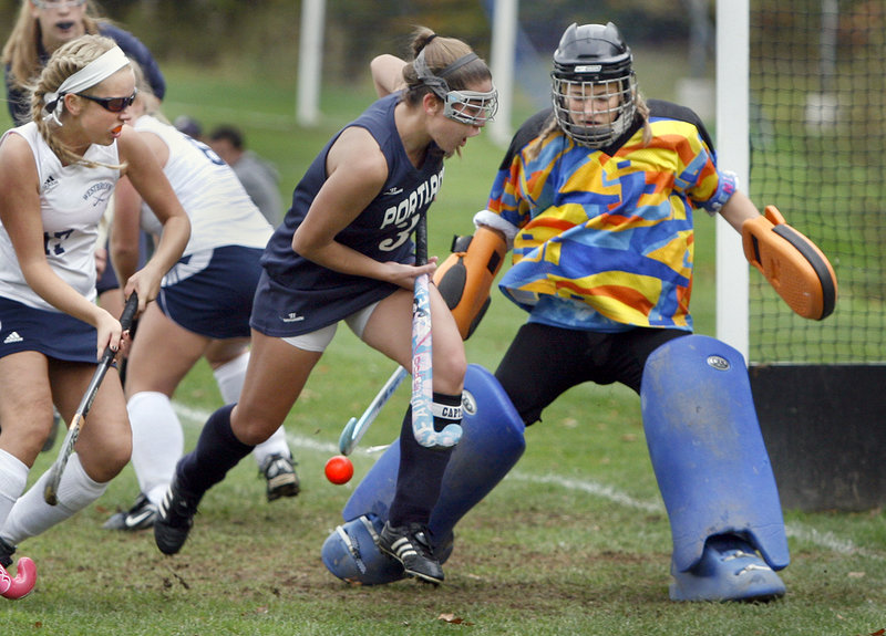 Westbrook goalie Maryssa Arsenault blocks a shot taken by Natalie Anderson of Portland as Katie Conley defends Saturday in the second half of their Western Class A field hockey semifinal. Portland won 2-1 and will meet Marshwood for the regional championship.