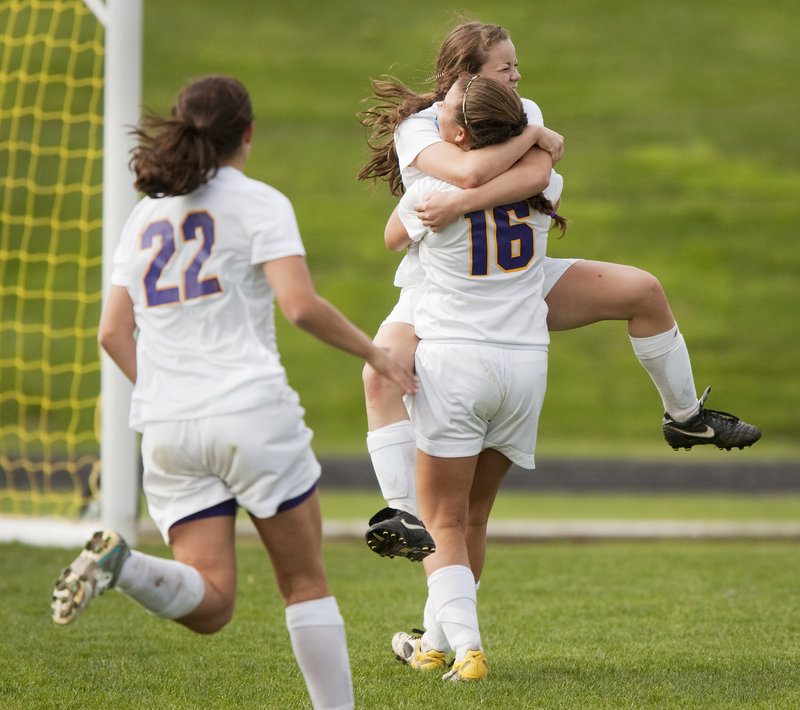 Abby Maker gets a hug from Leeann Morrison (16) after scoring the go-ahead goal late in the second half to give Cheverus a 2-1 playoff victory over Marshwood on Saturday.
