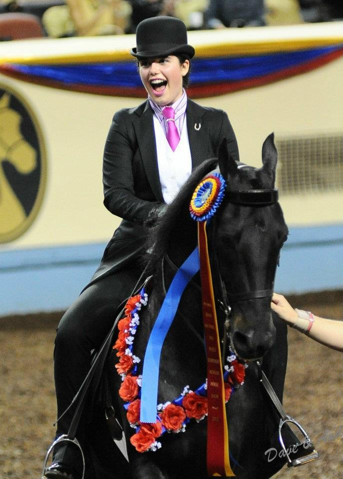 Gabrielle Blackman celebrates on her horse after winning the Classic Pleasure Saddle competition at the National Morgan Horse Show in Oklahoma City.