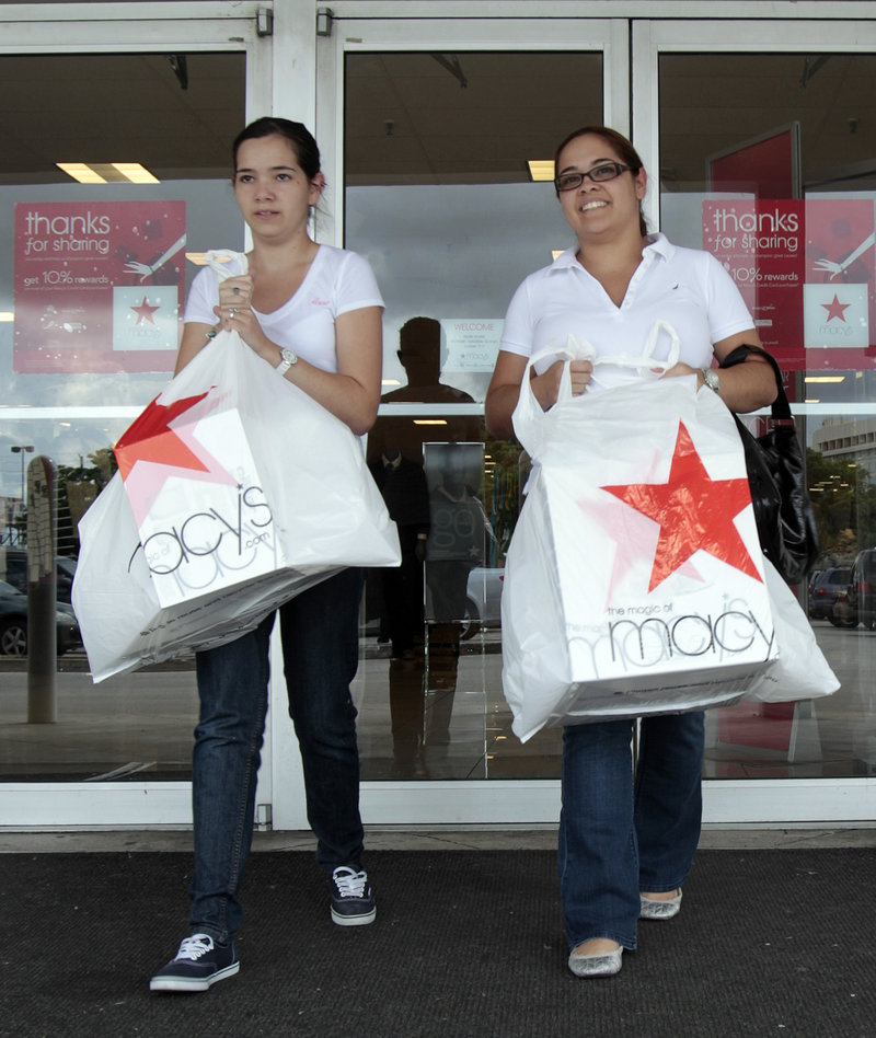 Elsy Santiago, left, and her sister Betsy shop at a store in Hialeah, Fla. Consumers boosted their spending in September at three times the pace of the previous month but their incomes barely budged.
