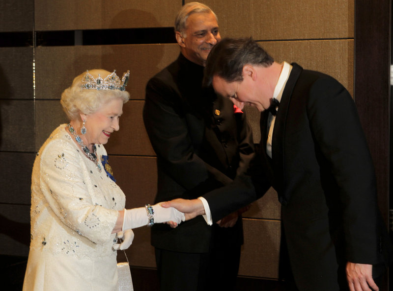 Queen Elizabeth II receives British Prime Minister David Cameron at the Commonwealth Heads of Government banquet held in Perth, Australia, on Friday. Cameron was among those advocating for change in the ancient rules favoring males in the line of succession to the throne.