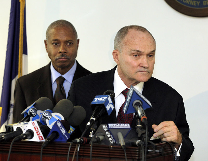 Bronx District Attorney Robert T. Johnson, left, looks on with Police Commissioner Ray Kelly at a news conference Friday about 17 police officers indicted for ticket-fixing.