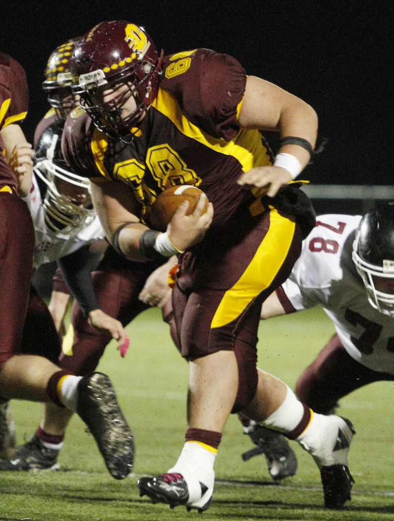 Andrew Lavallee of Cape Elizabeth finds room to run during his three-touchdown performance in the Capers' 21-9 win over Greely on Friday.