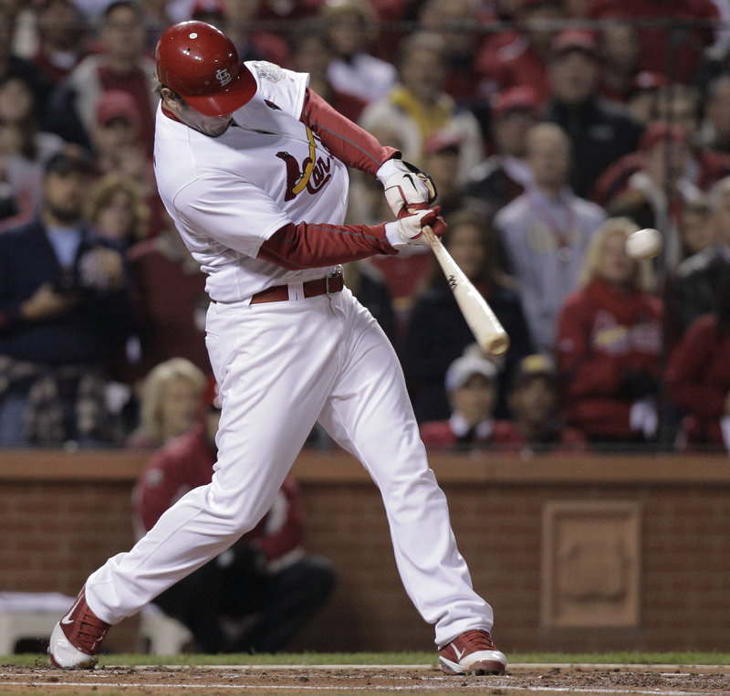 David Freese of the Cardinals drives through a two-run double in the first inning of Game 7. Freese earned the MVP award after hitting a record 21 RBI in the playoffs.