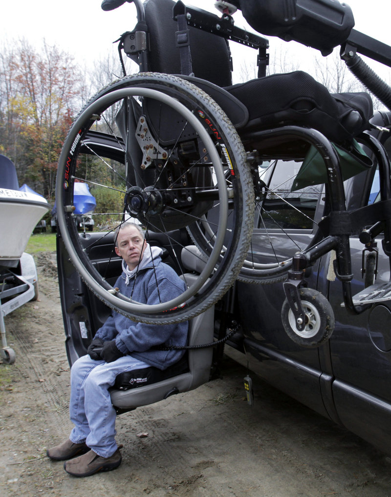 Nick Masi III maneuvers his wheelchair into his vehicle at a boatyard in Arundel after checking on his fishing boat, which was swamped at sea last month. Masi had taken several friends on a fishing trip off the Maine coast, but rough water swamped and overturned the boat. Despite a rescue, Masi's best friend did not survive the ordeal.