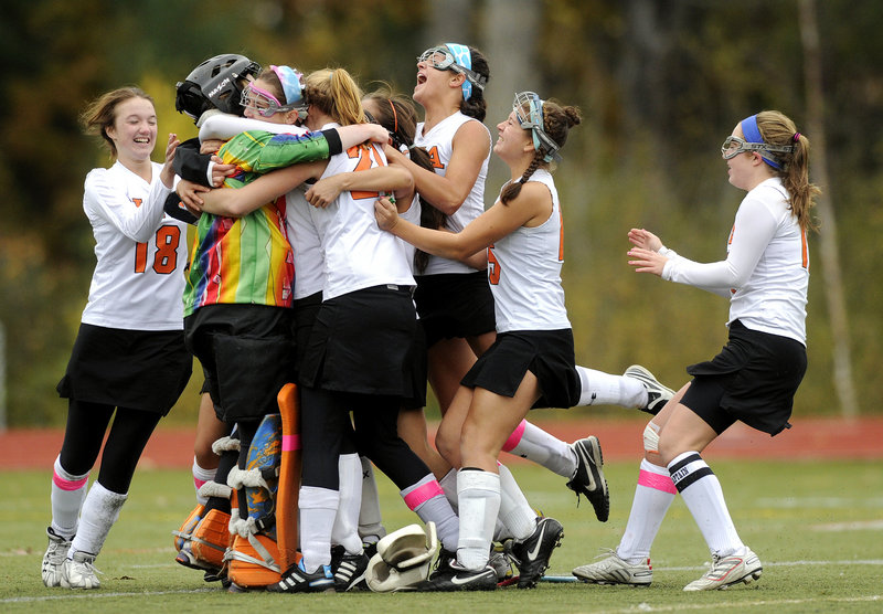Game over, title won, and the North Yarmouth Academy field hockey team celebrated a 1-0 victory against Winthrop on penalty corners – and a second consecutive Class C state championship.