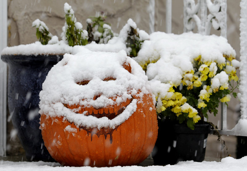 A jack-o'-lantern in North Bergen, N.J., is covered with snow during a rare October snowstorm that hit the Northeast on Saturday. The classic nor'easter was expected to dump a decidedly unseasonal wintry mix on Maine overnight.
