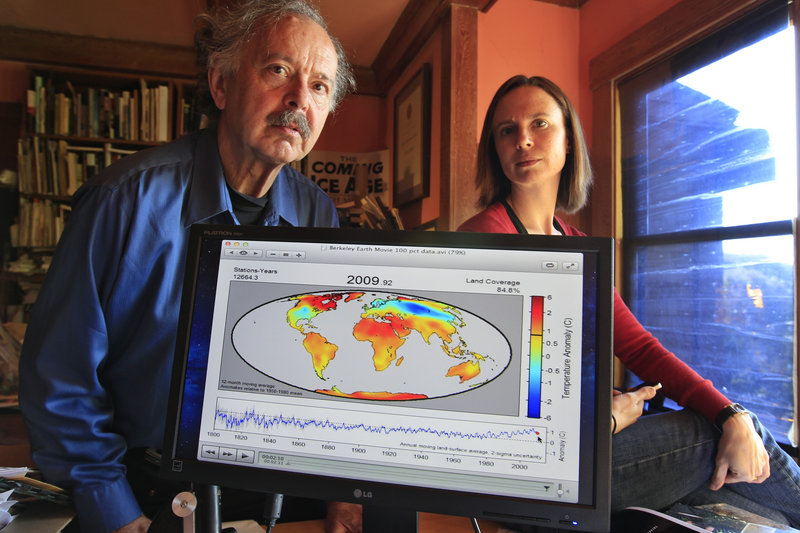 Richard Muller and his daughter, Elizabeth Muller, display a map from their study on climate, in Berkeley, Calif.
