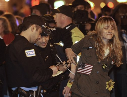 A protester is arrested early today during an Occupy Chicago march and protest in Grant Park in Chicago. Demonstrators of the anti-Wall Street group Occupy Chicago stood their ground in a downtown park and defied police orders to clear the area, prompting 130 arrests. OCCUPY CHICAGO