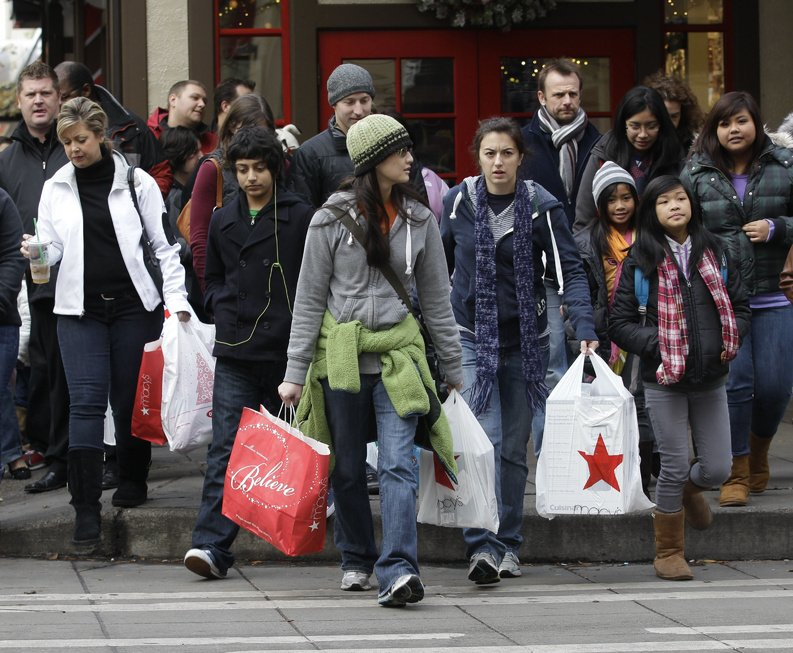 Shoppers carry their bags as they walk in downtown Seattle last fall. Spending by American shoppers has slowed to a crawl, prompting lawmakers, businesses and even White House officials to court consumers from cash-rich countries such as China, India and Brazil to pick up the slack.
