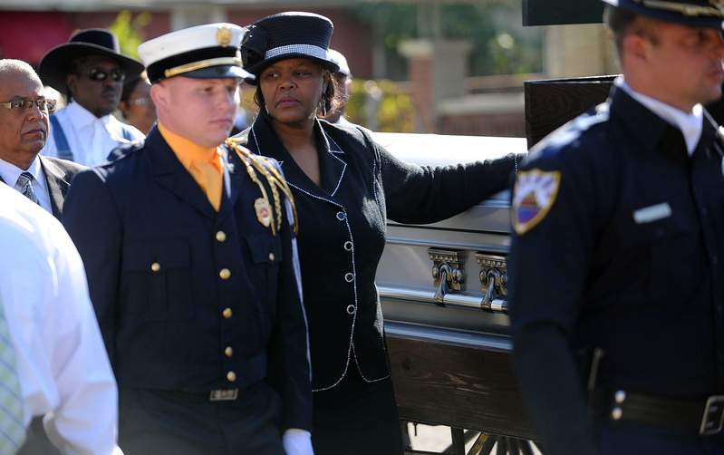 The Rev. Fred Shuttlesworth's widow, Sephira, puts her hand on his casket Saturday in Birmingham, Ala., during a march from the old Bethel Baptist Church to the current Bethel Baptist, where a memorial service was held. March honoring Rev. Fred Shuttlesworth
