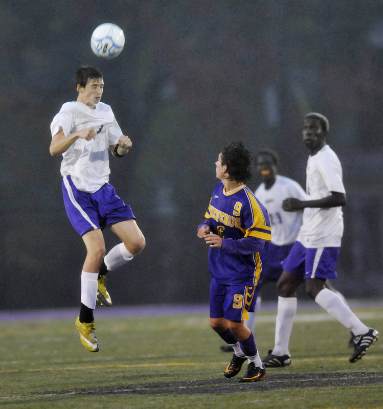 Brandon Saucier of Deering controls the ball with a header in front of Alexander Hoglund of Cheverus during Cheverus' 3-0 victory Thursday night.