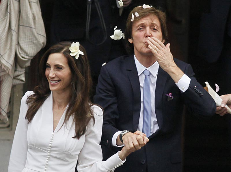 Former Beatle Paul McCartney and his bride, New Yorker Nancy Shevell, exit Old Marylebone Town Hall in London after their wedding Sunday.