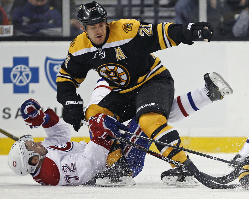 Montreal's Erik Cole hits the ice hard following a check from Boston's Andrew Ference during the Canadiens' 2-1 win Thursday in Boston. The Bruins' Brad Marchand squared off with P.K. Subban three times during the game.