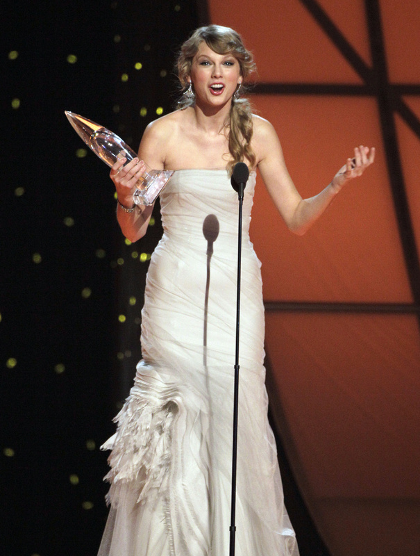 Taylor Swift accepts her second award for entertainer of the year during the 45th annual CMA Awards in Nashville, Tenn., on Wednesday.