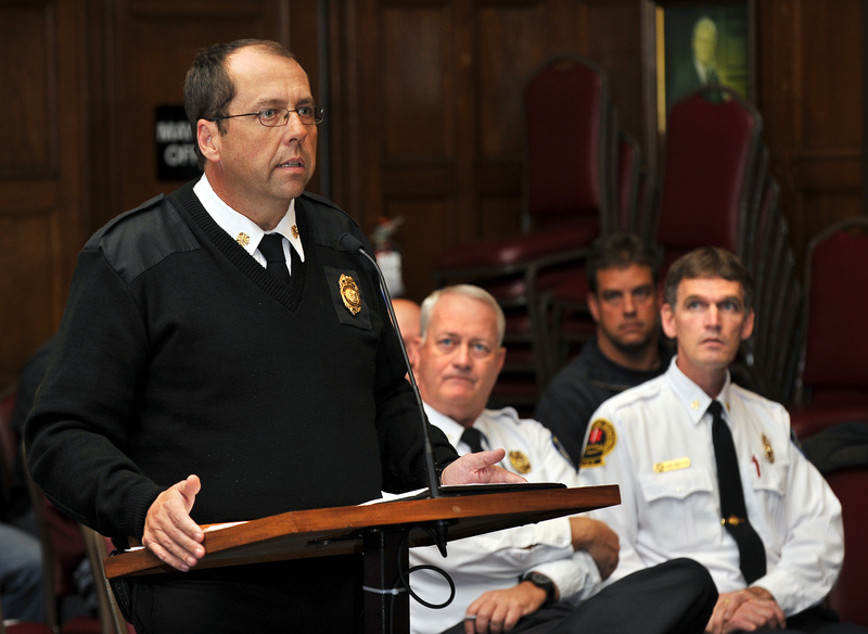 Portland Fire Chief Fred LaMontagne speaks about the proposed changes in regulations for use of the city's fireboat at a Public Safety Committee meeting Tuesday. Sitting are Deputy Fire Chief Terry Walsh, left, and Deputy Fire Chief David Pendleton.