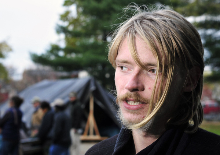 """Shane Blodgett, 21, an Occupy Maine member from Augusta who vows to stay in Portland's Lincoln Park """"regardless of how cold it gets"""" this winter, says violence in the Occupy Wall Street movement is counterproductive."""