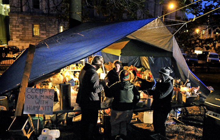 Occupy Maine members gather around the kitchen area of the Lincoln Park encampment.